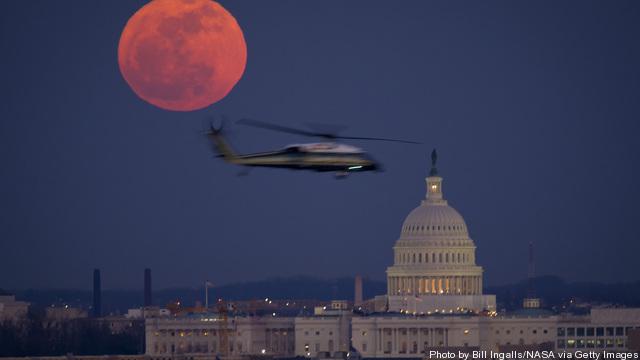 Full Moon Rises Above U.S. Capitol