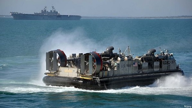 Navy LCAC hovercraft like this one carry Marine vehicles, supplies, and heavy equipment ashore.