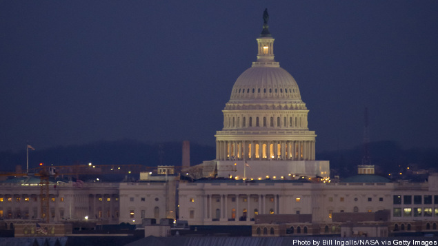 Full Moon Rises Above U.S. Capitol
