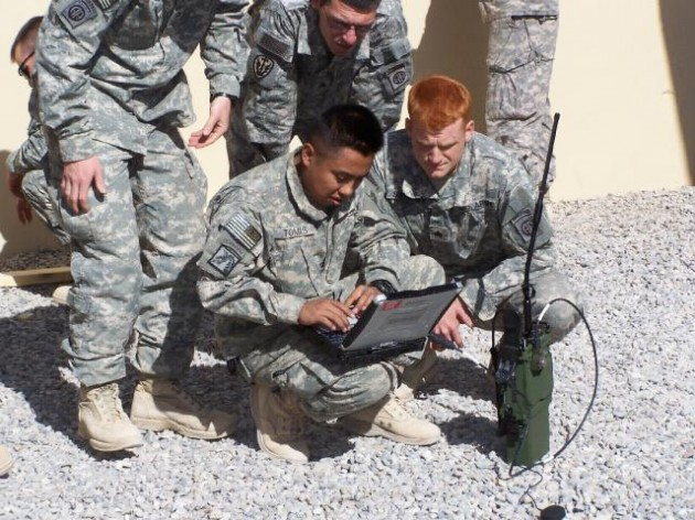 Soldiers use a Harris PRC-117G radio in Afghanistan