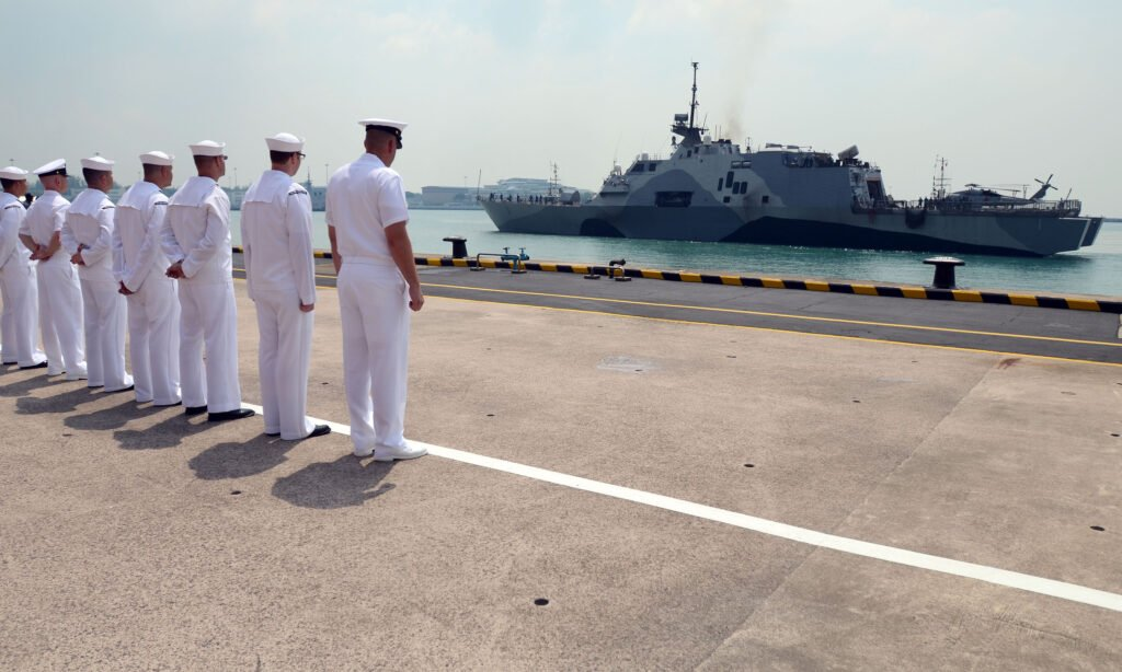 SINGAPORE (April 18, 3013) Sailors attached to Forward Liason Element, USS Freedom (LCS 1), observe Freedom as it arrives in Singapore during an eight-month deployment to Southeast Asia. Fast, agile, and mission focused, LCS platforms are designed to employ modular mission packages that can be configured for three separate purposes: surface warfare, mine countermeasures, or anti-submarine warfare. Freedom will remain homeported in San Diego throughout this deployment to Southeast Asia. (U.S. Navy photo by Mass Communications Specialist 1st Class Jay C. Pugh/Released)