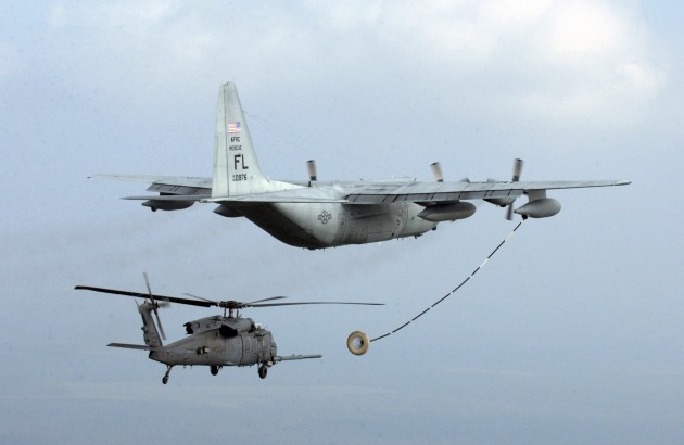 An Air Force Special Operations tanker refuels a helicopter searching for survivors of 2005's Hurricane Rita.