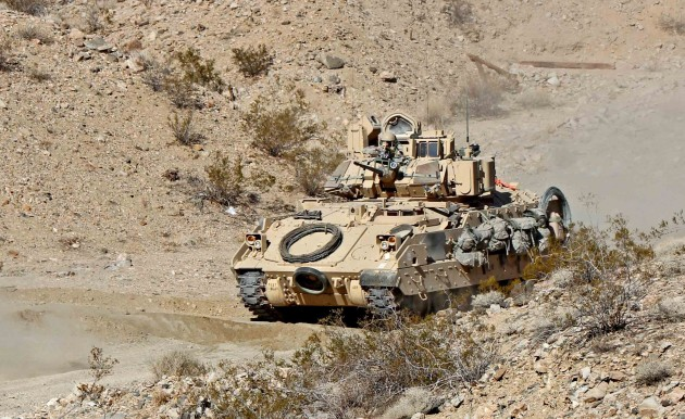 An Army M2 Bradley trains at the National Training Center in California in January. Since then, budget cuts have forced the Army to cancel most such exercises.
