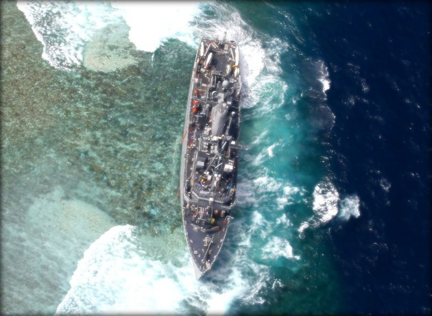 USS Guardian lies crippled on UNESCO World Heritage Tubbataha Reef in the Philippines