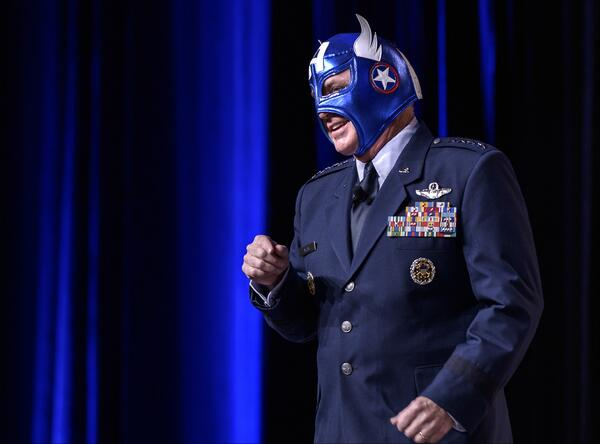 Gen. Mark Welsh, chief of staff of the Air Force, addresses the faithful wearing a Captain America mask.