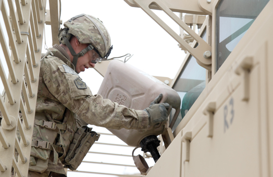 A soldier refuels his mine resistant ambush protected vehicle during a convoy break in Afghanistan. DLA Energy provides the Army with petroleum, coal, natural gas and helium, among other energy products. Photo by Army Sgt. Kimberly Trumbull