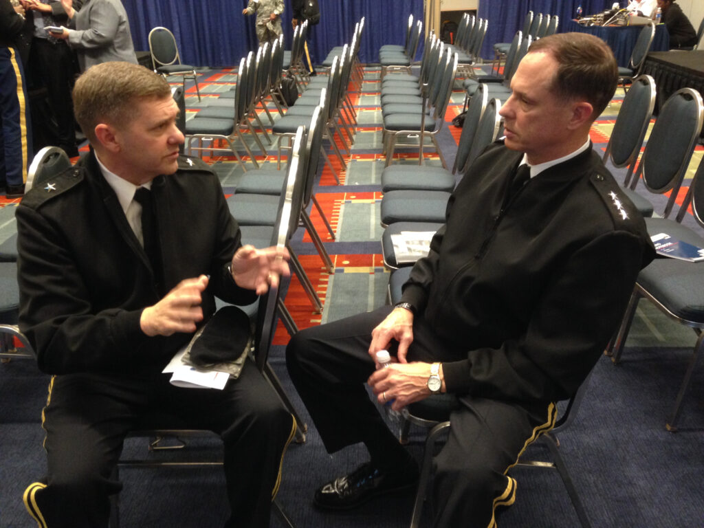 Army Maj. Gen. Hughes (left) and Lt. Gen. Walker (right) discuss the services' network upgrade plans.
