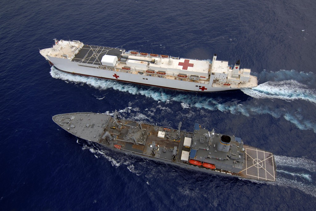 The US hospital ship Mercy gets resupplied at sea.