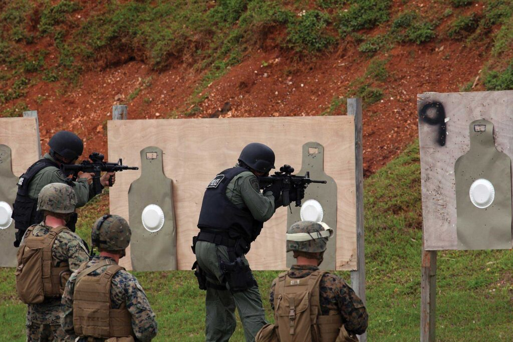 A Guam Police Department SWAT team trains with US Marines. The Pentagon plans to station an additional 5,000 Marines on the island, but its public services and infrastructure aren't yet ready for the influx.