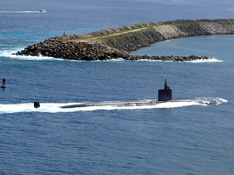 A US Navy attack submarine enters Apra Harbor in Guam.