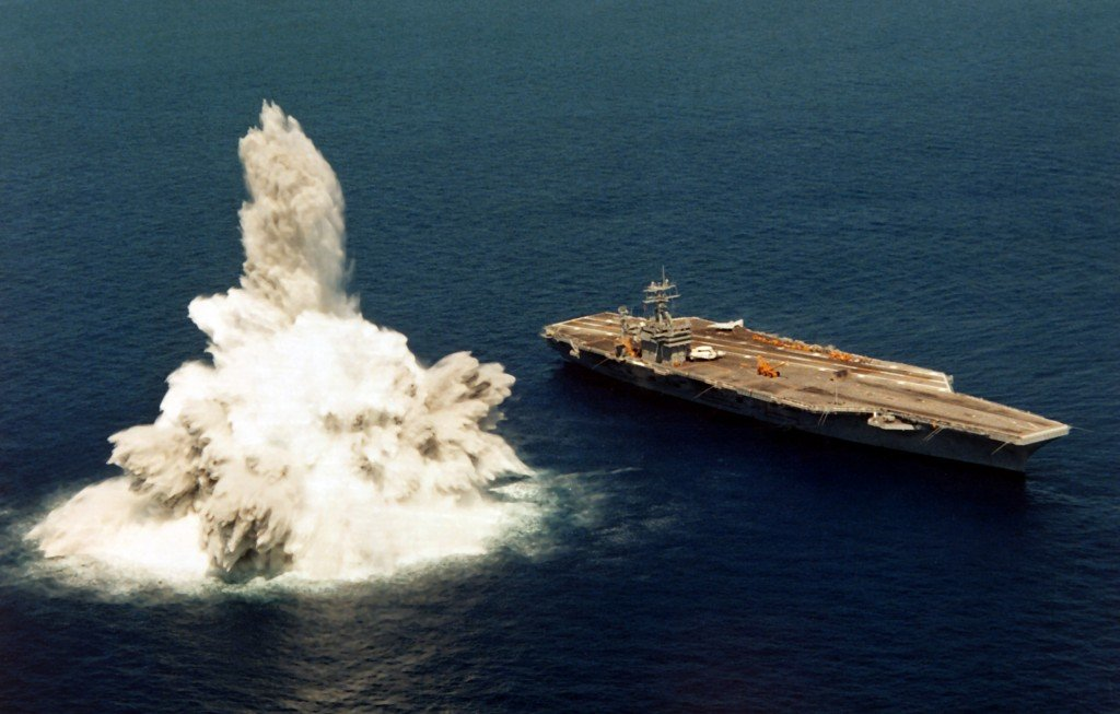 "A US Navy carrier, the USS Roosevelt, undergoing ""full-ship shock trials"" using live explosives."