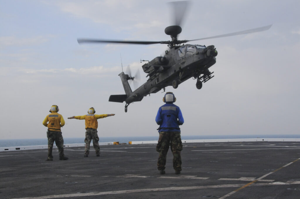 A National Guard AH-64 Apache lands on a Navy ship -- a rare skill in the Army. But the Pentagon's budget plans would move all Guard Apaches to active-duty units.