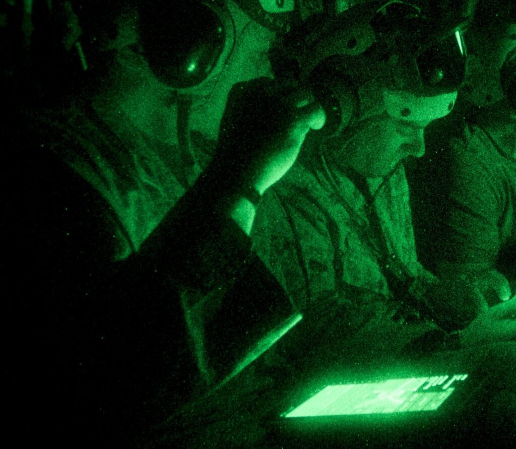 Marines use off-the-shelf Samsung tablets to coordinate operations from the back of a V-22 Osprey in an Infantry Officer Course experiment.