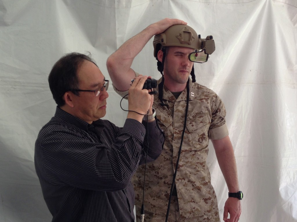A Marine Captain and a BAE contractor with DARPA's prototype ULTRA-Vis helmet display.