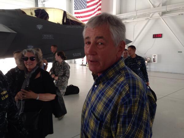 Defense Sec. Chuck Hagel jokes with reporters at Eglin Air Force Base. (The aircraft behind him is an F-35A).