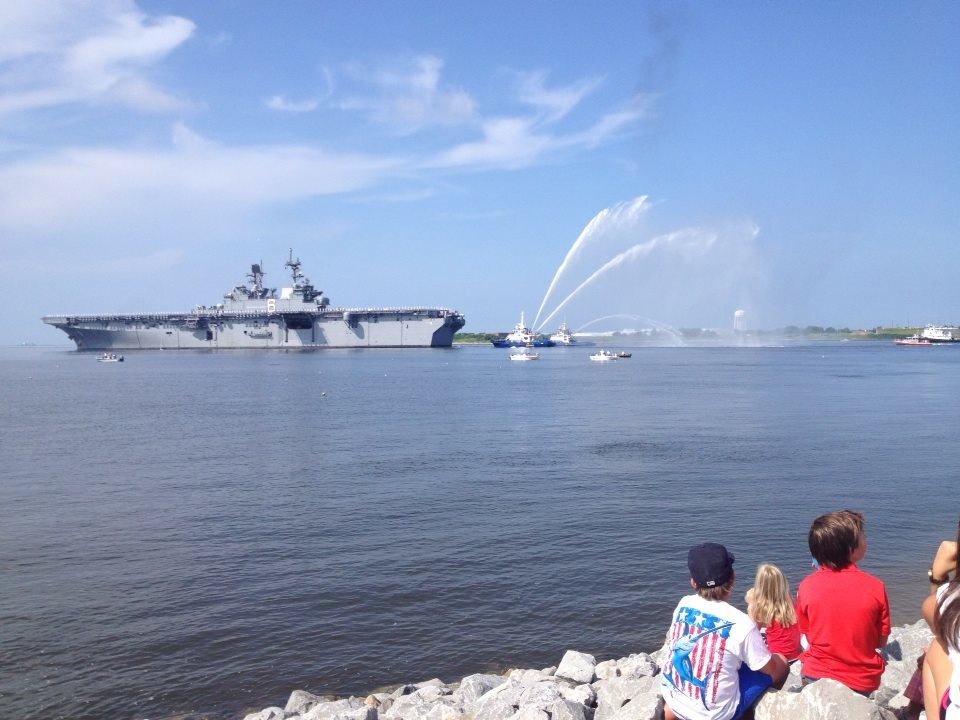 LHA-6 USS America sails - kids in foreground