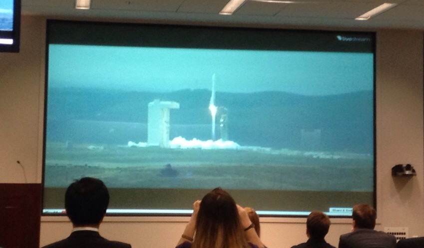 Lockheed Martin employees and guests watch the launch of the WorldView-3 satellite Wednesday.