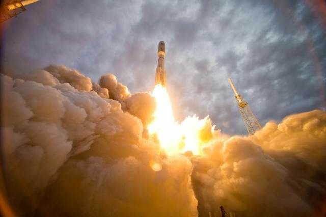 Russian-made RD-180 engines propel an Atlas V rocket heavenward.