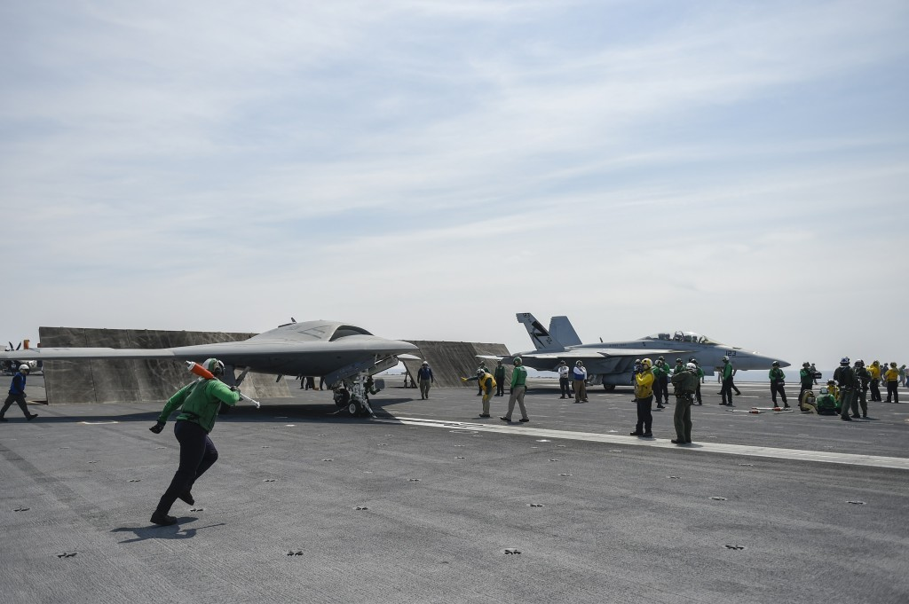 The U.S. Navy's unmanned X-47B conducts flight operations aboard the aircraft carrier USS Theodore Roosevelt (CVN 71). The aircraft completed a series of tests demonstrating its ability to operate safely and seamlessly with manned aircraft. Operating alongside an F/A-18, the X-47B demonstrated two successful launch and recovery sequences. The Theodore Roosevelt is currently underway preparing for future deployments. Photo by Alan Radecki.