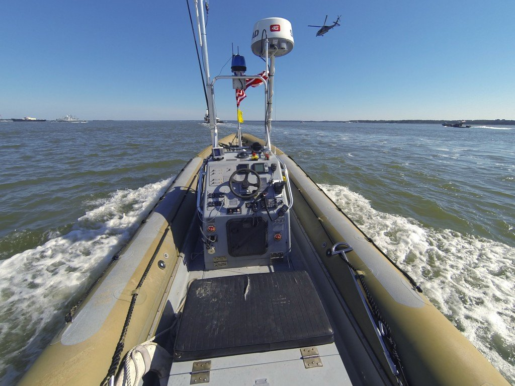 "A Navy patrol boat converted to operate unmanned as part of an Office of Naval Research experiment in autonomous ""swarms."""