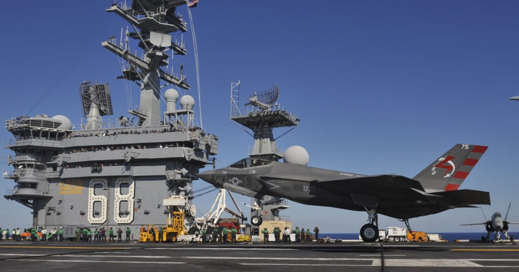 A Navy F-35C conducts its first-ever arrested landing aboard the carrier USS Nimitz