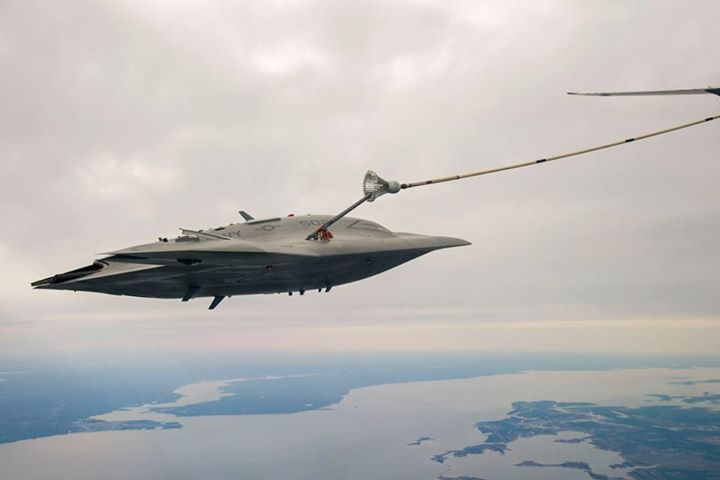 The X-47B drone plugs into an aerial refueling tanker for the first time.