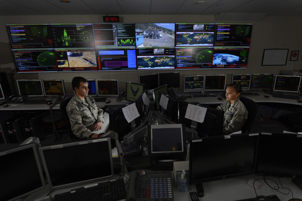 Staff Sgt. Alex Garviria, 721st Communication Squadron senior systems controller, and 2nd Lt. Rachel James, 721st CS crew commander, work in the Global Strategic Warning and Space Surveillance System Center at Cheyenne Mountain Air Force Station, Colo., Sept. 2, 2014. The 721st CS provides continuous monitoring of the strategic missile warning systems to ensure a constant dataflow of key information to North American Aerospace Defense Command (NORAD), U.S. Northern Command, U.S. Strategic Command, Air Force Space Command, Secretary of Defense, President of the United States, strategic, and theater commanders. (U.S. Air Force photo by Airman 1st Class Krystal Ardrey)