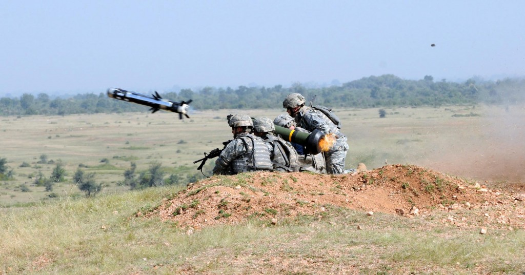 Army soldiers fire a Javelin anti-tank missile.