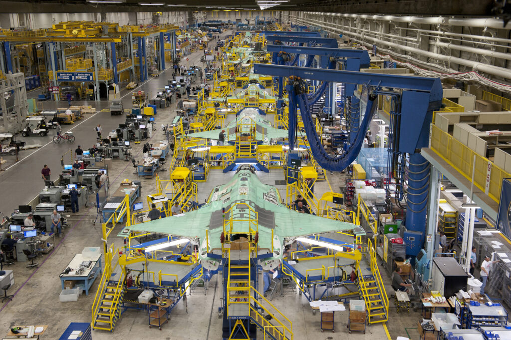 Workers can be seen on the moving line and forward fuselage assembly areas for the F-35 Joint Strike Fighter at Lockheed Martin Corp's factory located in Fort Worth, Texas in this October 13, 2011 handout photo provided by Lockheed Martin. Lockheed Martin Corp on February 25, 2013 said there was no evidence that a lithium-ion battery contributed to a Feb. 14 incident that caused smoke in the cockpit of an F-35 test plane. Lockheed spokesman Michael Rein said initial reviews indicated a potential failure in the plane's cooling system, which had been removed from the aircraft for further study.  Picture taken October 13, 2011.  REUTERS/Lockheed Martin/Randy A. Crites/Handout (UNITED STATES - Tags: MILITARY)  ATTENTION EDITORS - THIS IMAGE WAS PROVIDED BY A THIRD PARTY. FOR EDITORIAL USE ONLY. NOT FOR SALE FOR MARKETING OR ADVERTISING CAMPAIGNS. THIS PICTURE IS DISTRIBUTED EXACTLY AS RECEIVED BY REUTERS, AS A SERVICE TO CLIENTS - RTR3EAKJ